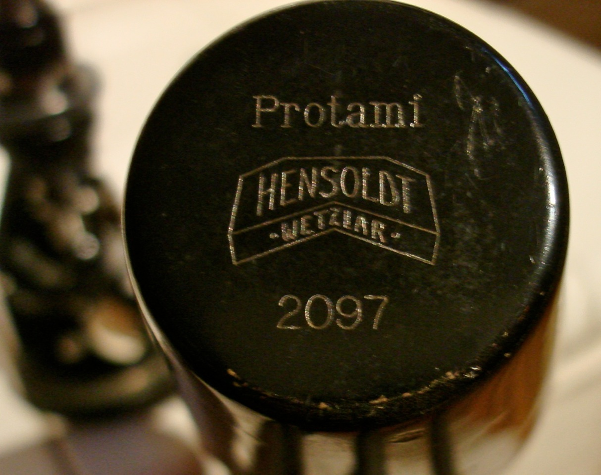 ... Bononiae Microscope - Hensoldt Protami 2097, top of metal cover ...